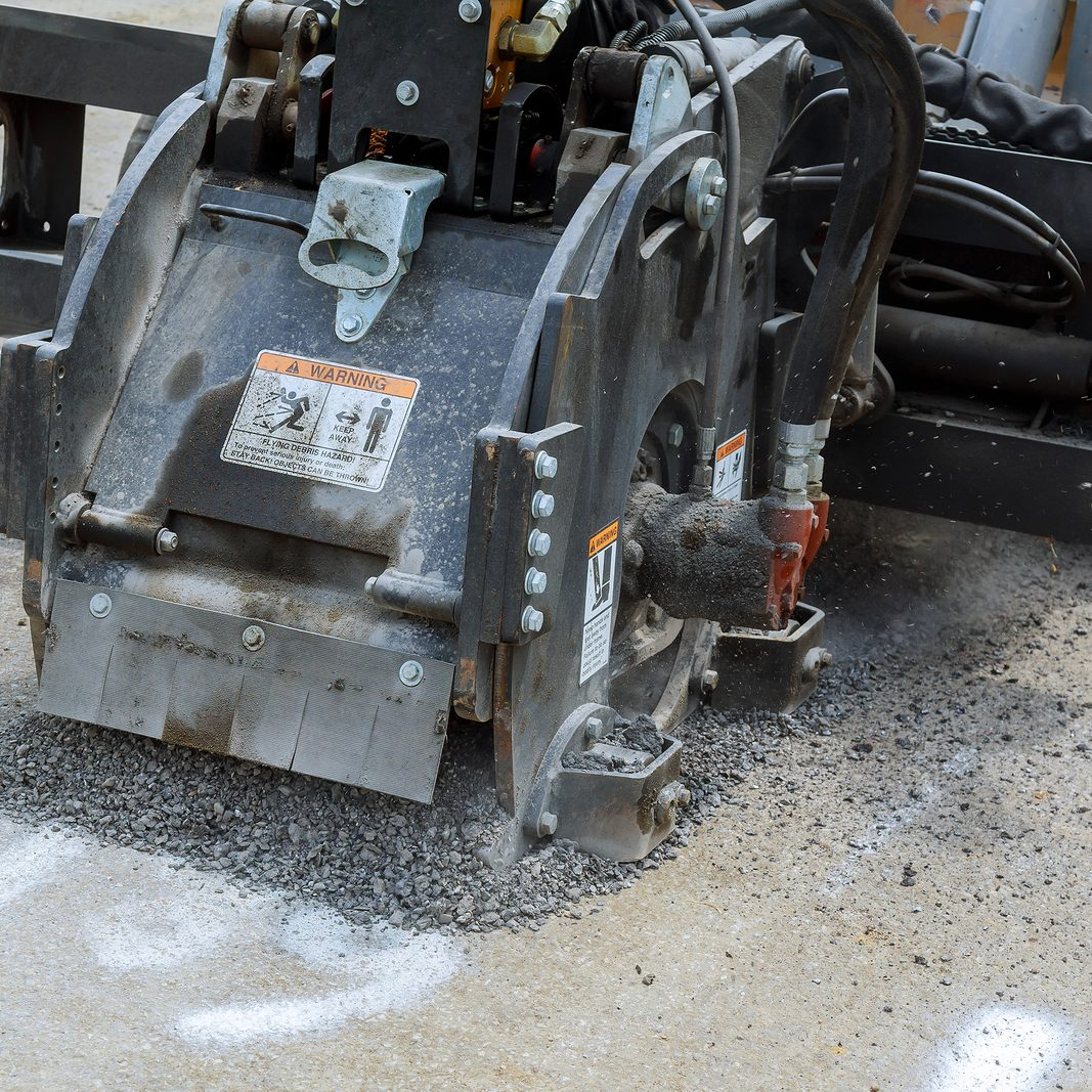 Milling of asphalt for road repair of roads, the removes old asphalt reconstruction accessory for skid steer